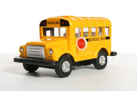 A small toy school bus over white photo