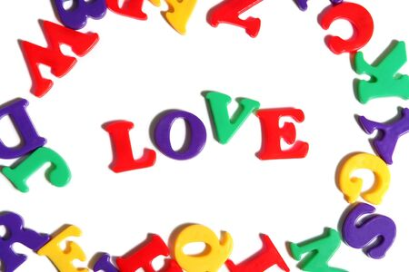 Love spelled out among colorful toy letters Stock Photo - 954115