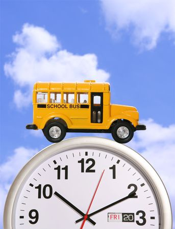 A yellow school bus driving on a clock Stock Photo - 966097