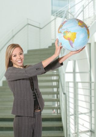 A pretty business woman holding the globe in the sky photo