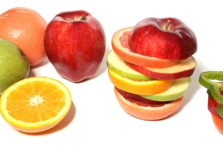 Mixed fruit, apples, oranges, pepper, grapefruit, pear over white Stock Photo - 966111