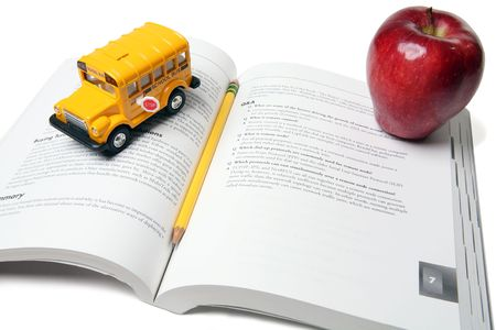 School bus, book, apple and pencil in education themed display Stock Photo - 981514