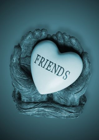 Hands statue holding a heart with friends engraved on a heart Stock Photo - 991450
