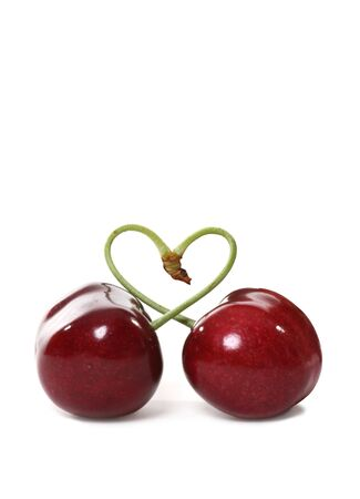 Two cherries tied together in a heart signifying love Stock Photo - 1016419