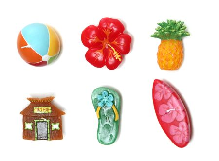 Beach ball, lei, pineapple, sandal, hut, and surfboard candles with a Hawaii theme photo