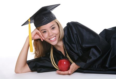 A beautiful woman at graduation with an apple photo