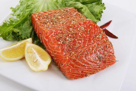 garnishments: Salmon marinating on a dish with garnishments Stock Photo