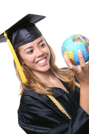 A pretty woman graduate holding a small globe Stock Photo - 1133353