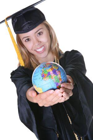 A pretty woman graduate holding a small globe photo