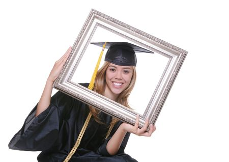 A pretty woman graduating holding a picture frame photo