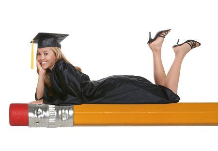 A beautiful woman graduate laying on pencil 免版税图像