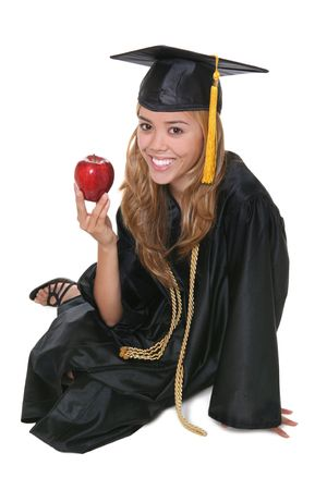A beautiful woman graduate with an apple over white Stock Photo - 1172441