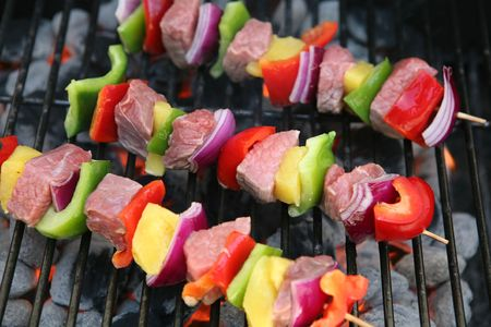 Colorful kabobs cooking on the grill with meat and vegetables Stock Photo - 1187199