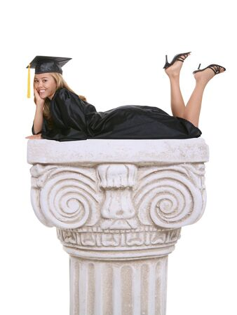 A beautiful woman  graduate laying on an architectural column photo