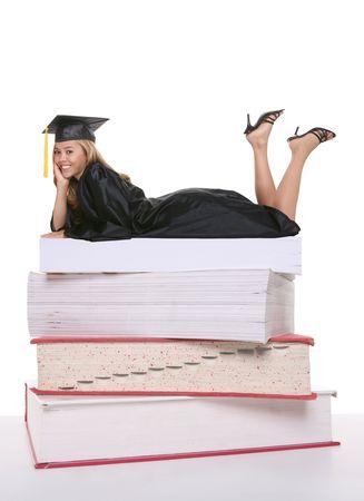 A beautiful young woman graduate on books Stock Photo - 1201151