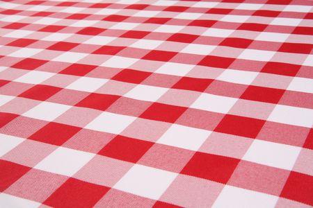 Een traditionele plaid picknick tafel laken weefsel Stockfoto