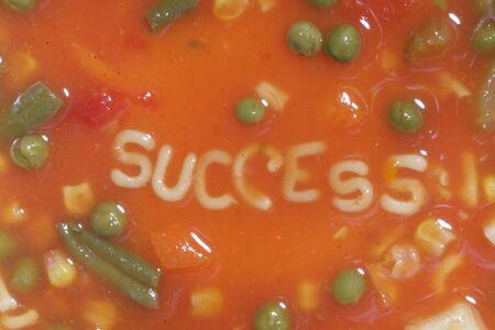 A bowl of alphabet soup with the word success in the middle Stock Photo - 1201169