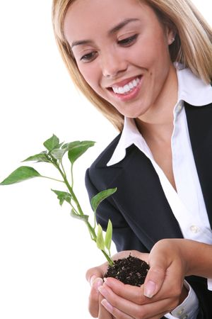 A pretty business woman holding a growing plant  photo