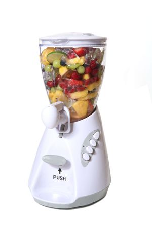 Colorful fruit and ice in a blender photo