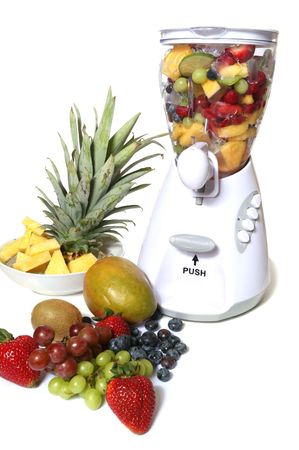stirrer: Colorful fruit and ice in a blender Stock Photo