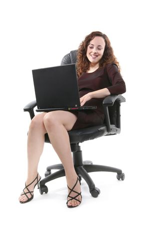 A pretty business woman using her laptop computer Stock Photo - 1280907