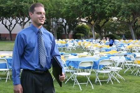 A business man attending a banquet outside