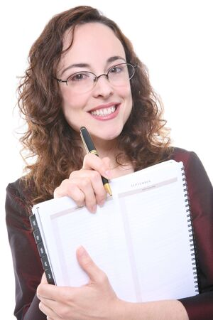 A pretty business woman holding a pen and calendar Stock Photo - 1290972