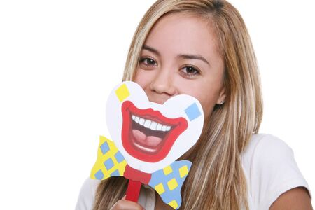 A pretty young woman putting on a happy clown face