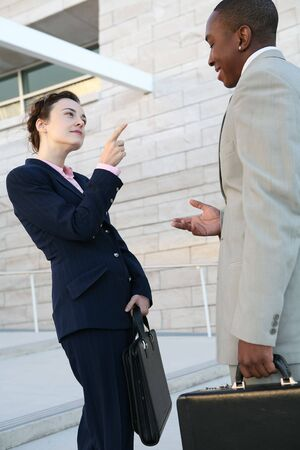 Two business people talking outside the company Stock Photo - 1318741