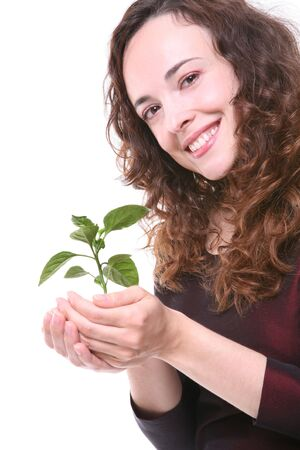 growing plant: A pretty business woman holding a growing plant