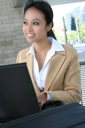 A pretty asian business woman working on her laptop computer Stock Photo - 1343233