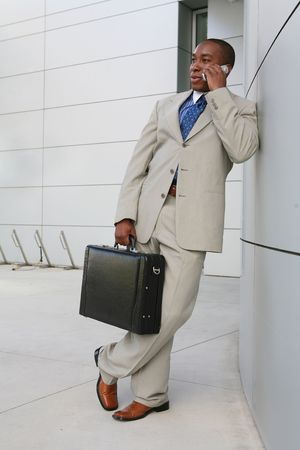 A handsome business man on the phone outside his office Stock Photo - 1343246