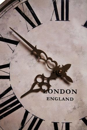 An old antique vintage grandfather clock close-up photo