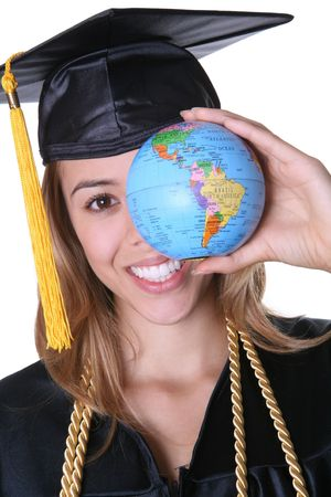 A pretty woman graduate holding a small globe photo