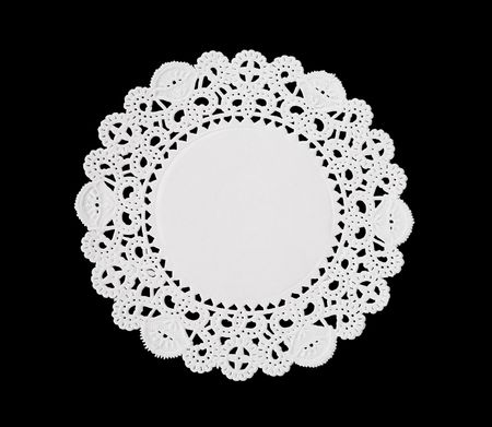placemat: A decorative round doily isolated over black Stock Photo