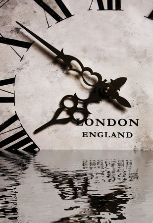 An old antique vintage grandfather clock in the water photo
