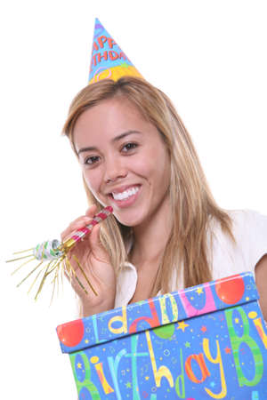 A pretty young birthday girl holding a present photo