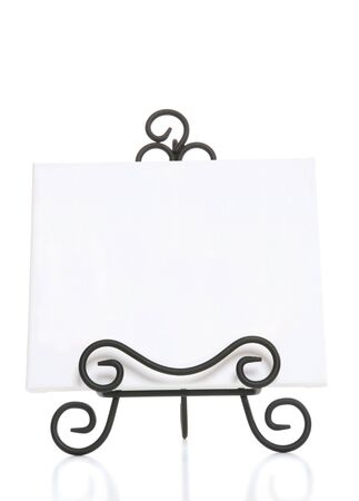An art easel for a painter over a white background photo