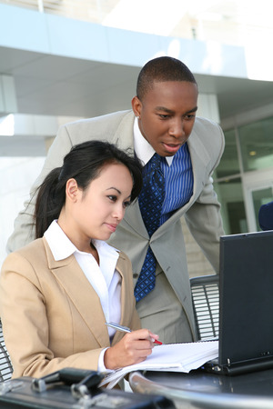 A diverse business team working on a laptop computer Stock Photo - 1396913