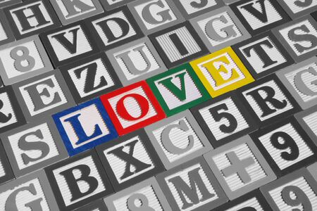 Toy wooden blocks spelling out the word love Stock Photo - 1431386