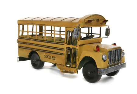 An old antique school bus over a white background Stock Photo - 1439887