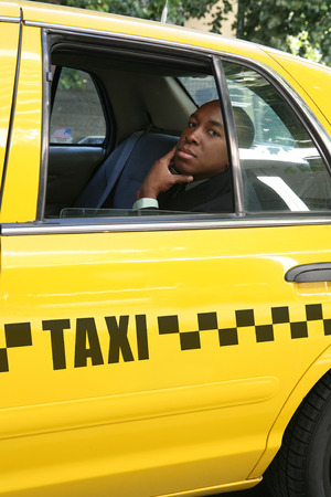 A business man inside a taxi cab photo