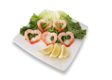 garnishments: Shrimp on a plate in the shape of hearts