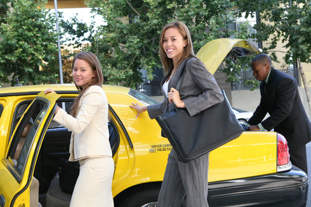 black cab: A pretty business woman getting into a taxi cab Stock Photo