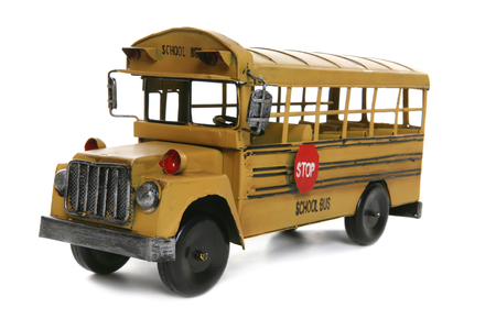 An old antique school bus over a white background photo
