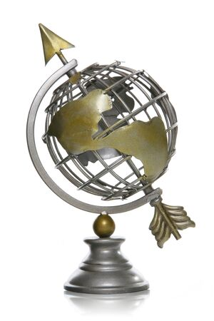 A wire globe of the earth with an arrow going through 免版税图像