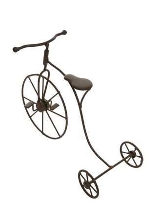 antique tricycle: An antique bicycle isolated over a white background Stock Photo