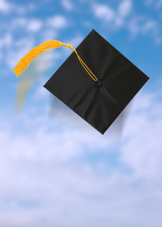 A graduation cap after being thrown into the blue sky
