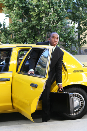 A business man getting out of a taxi cab Stock Photo