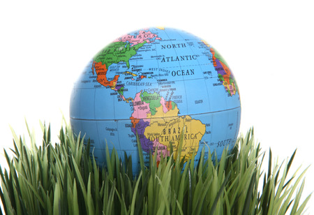A colorful globe laying in the green grass photo